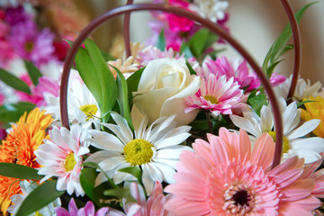Bouquet of flowers roses gerbera flowers carnations . Roses, gerbera and other flowers arranged as a colorful natural background image with white, yellow and pink blossoms - Image