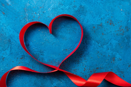 Valentines Day background with red heart. Heart shape from ribbons. Happy Valentine Day