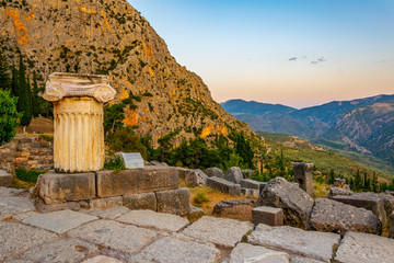an old column situated at the ancient Delphi site in Greece