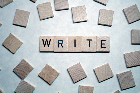The word Write written in square wood block letters on a white background, surrounded by blank squares