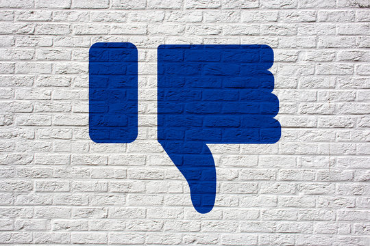 I Dislike social media Icon Graffiti (Thumbs up on bricks wall)
