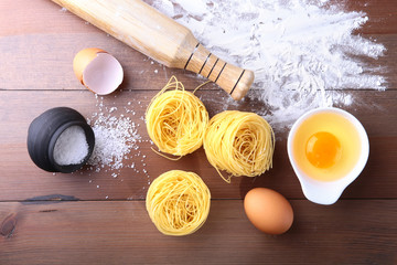 egg, flour, salt ingredients for pasta spaghetti. Cooking concept. Top view.