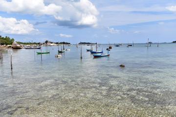 Small fishing boats at the beach of Tanjung Kelayang in Belitung Island, Indonesia