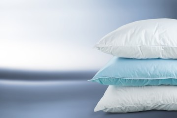 Soft Pillows Pile on grey background, three pillow, sleeping
