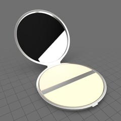 Powder compact with mirror