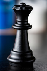 chess black queen closeup on a blurred background