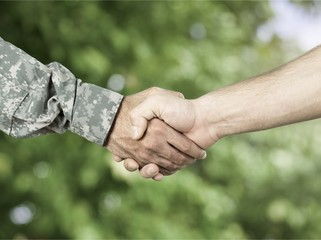 Business Agreement Handshake on background, close up