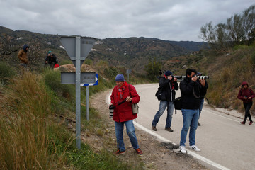 Photographers take photos at the area where Julen fell into a deep well, in Totalan
