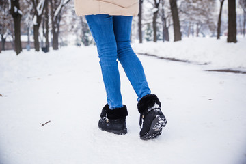 Woman walking in snow time