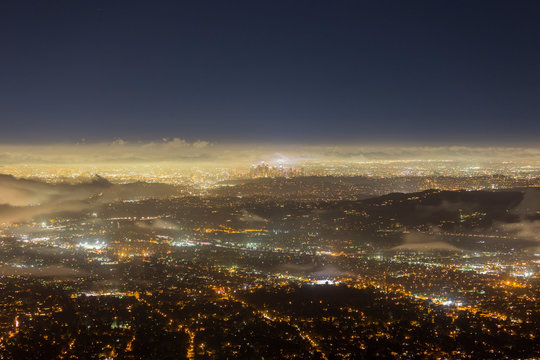 Night fog view of Pasadena and Los Angeles from peak in the San Gabriel Mountains.