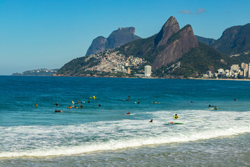 Rio de Janeiro city / Brazil South America - 08/29/2018: Surfers waiting for the perfect wave. Wonderful places in the world for surfing.