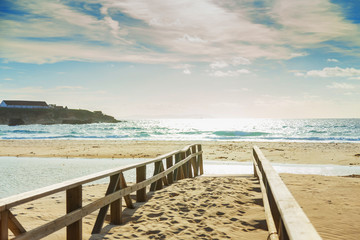 wooden bridge on a sandy beach