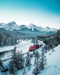 Tuinposter Canada Morant's Curve with train in winter, Banff National Park, AB, Canada