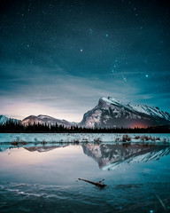 Zelfklevend Fotobehang Groen blauw Beautiful night full of stars above Mt Rundle, Vermilion Lakes and Banff town, Banff National Park, Canadian Rockies, Rocky Mountains, Travel Alberta, Canada, North America