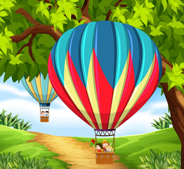 Cgroup of children riding hot air balloon