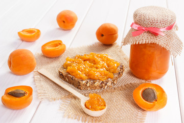 Fresh prepared snack with apricot marmalade, healthy sweet eating concept