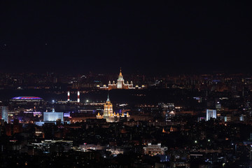 Night panorama of Moscow from Ostankinskaya tv tower with Moscow State University, Hotel Ukraine, White House, and Luzhniki stadium
