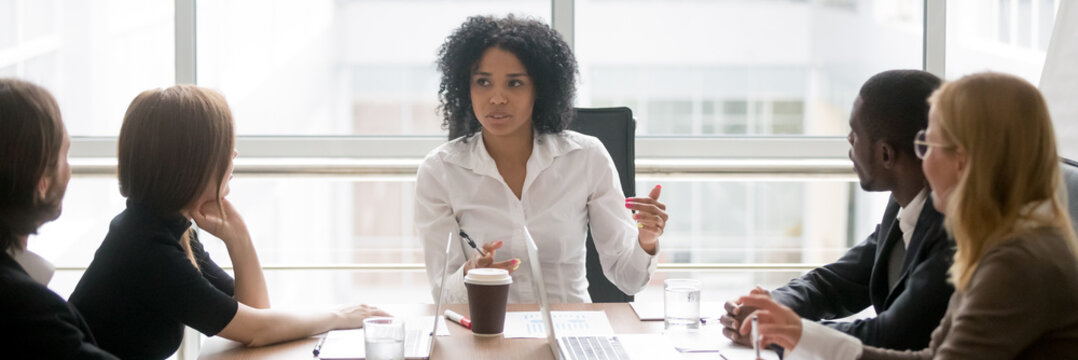 Horizontal photo people sitting at boardroom african business woman talking with staff at formal meeting briefing, diverse client partners listens boss ceo team leader banner for website header design