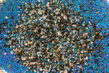 Layered colorful sand pattern. Marble style background. Blue and gold powder texture.