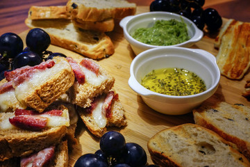 Red wine and appetizers on wooden background