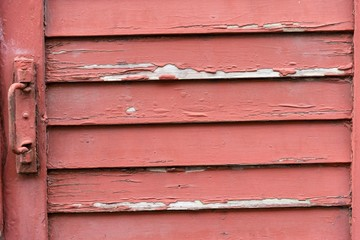 Peeling paint on wooden board close up