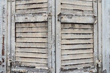 Old wooden shutter with peeling paint