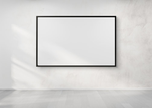Black frame hanging on a wall mockup 3d rendering