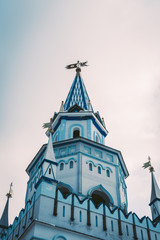 Beautiful blue tower with a weather vane on the roof. It is part of the Izmailovo Kremlin in Moscow.