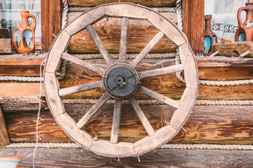 Old wooden wheels as an element of decor
