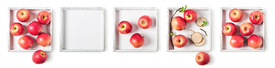 Apples on white wooden tray set.