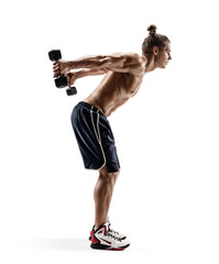 Sporty man doing exercises with dumbbells. Photo of man with naked torso isolated on white background. Strength and motivation. Side view. Full length