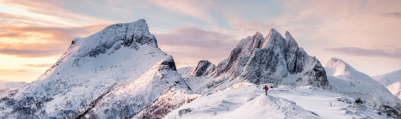Panorama of Steep peak mountains with covered snow and mountaineer man backpacker Fototapete