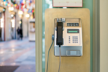 using of public payphone. old payphone in the street f