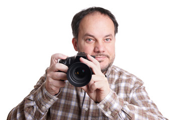 middle aged man holding dslr camera and smiling
