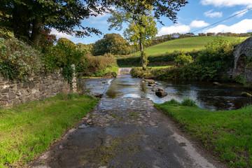 Crossing Badgworthy Water in Malmsmead, Devon, England, UK