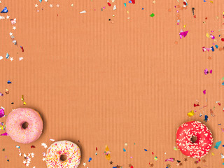 colorful brown carnival background with donuts and other funny items
