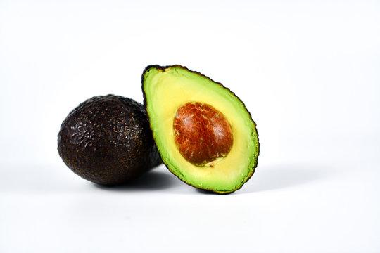 Fresh avocado cut in half with seed.