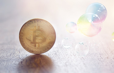 bitcoin coin and soap bubbles - concept image