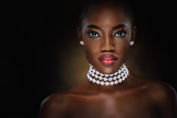 Vogue style close-up portrait of beautiful black woman