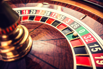 Roulette wheel in casino with ball on green position zero