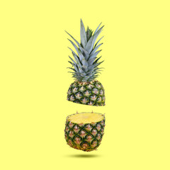 Fresh tropical fruit pineapple on yellow background.