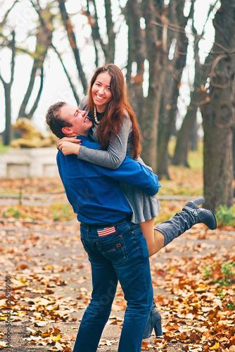 guy picking girl up