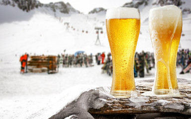 Winter beer and mountains landscape