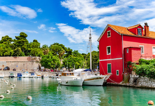 Boats and fishing boats on the pier in Fosa Bay in the spa town of Zadar in Croatia.