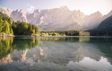 Superior Fusine Lake with Mount Mangart on the background. Fusine Lakes Natural Park, Tarvisio, Udine province, Friuli Venezia Giulia, Italy. Wall mural