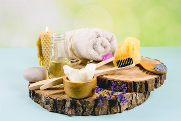 Using natural material products in home, different cosmetic products in bathroom. Minimizing ecological footprint concept. Bamboo bath towel, biodegradable bamboo toothbrush, clay mask, coconut oil.