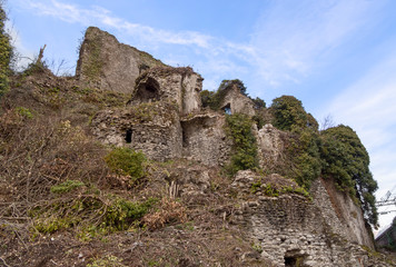 Section of the old Malnido castle ruins in Villafranca in Lunigiana, Italy. Removal of vegetation work in progress January 2019.