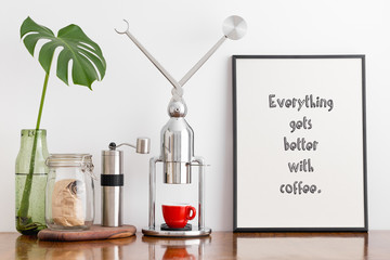 Coffee maker, grinder and Poster: Everything gets better with coffee.