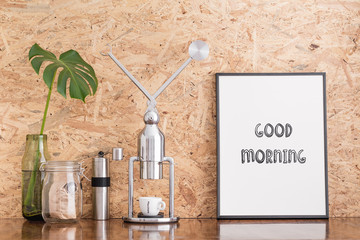 Coffee maker, grinder and Poster: Good morning.