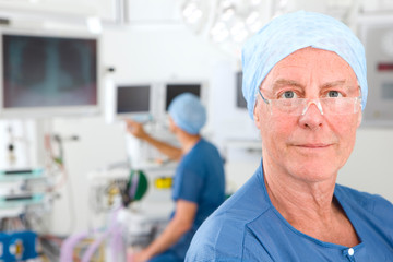 Male member of surgical team in hospital operating room looking at camera